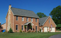 2 story brick farm house with attached 2 car garage